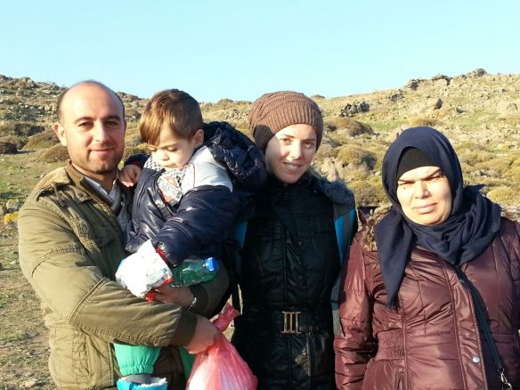 """""""This beautiful family are from Syria. They left Damascus about a week ago. They arrived here two days ago. Wee Hassan is just two years old. His father is Miteb and his mother Zuhoor which means flower in Arabic. The women in the scarf is Ateeyah, Miteb's sister. They are heading to Germany."""""""