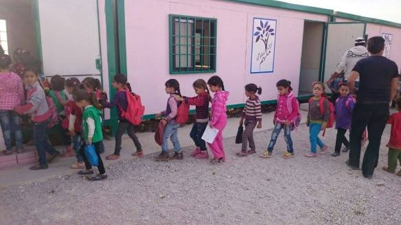 Children line by at the Al-Molham camp school in Arsal, Lebanon. Picture courtesy of Maggie Tookey